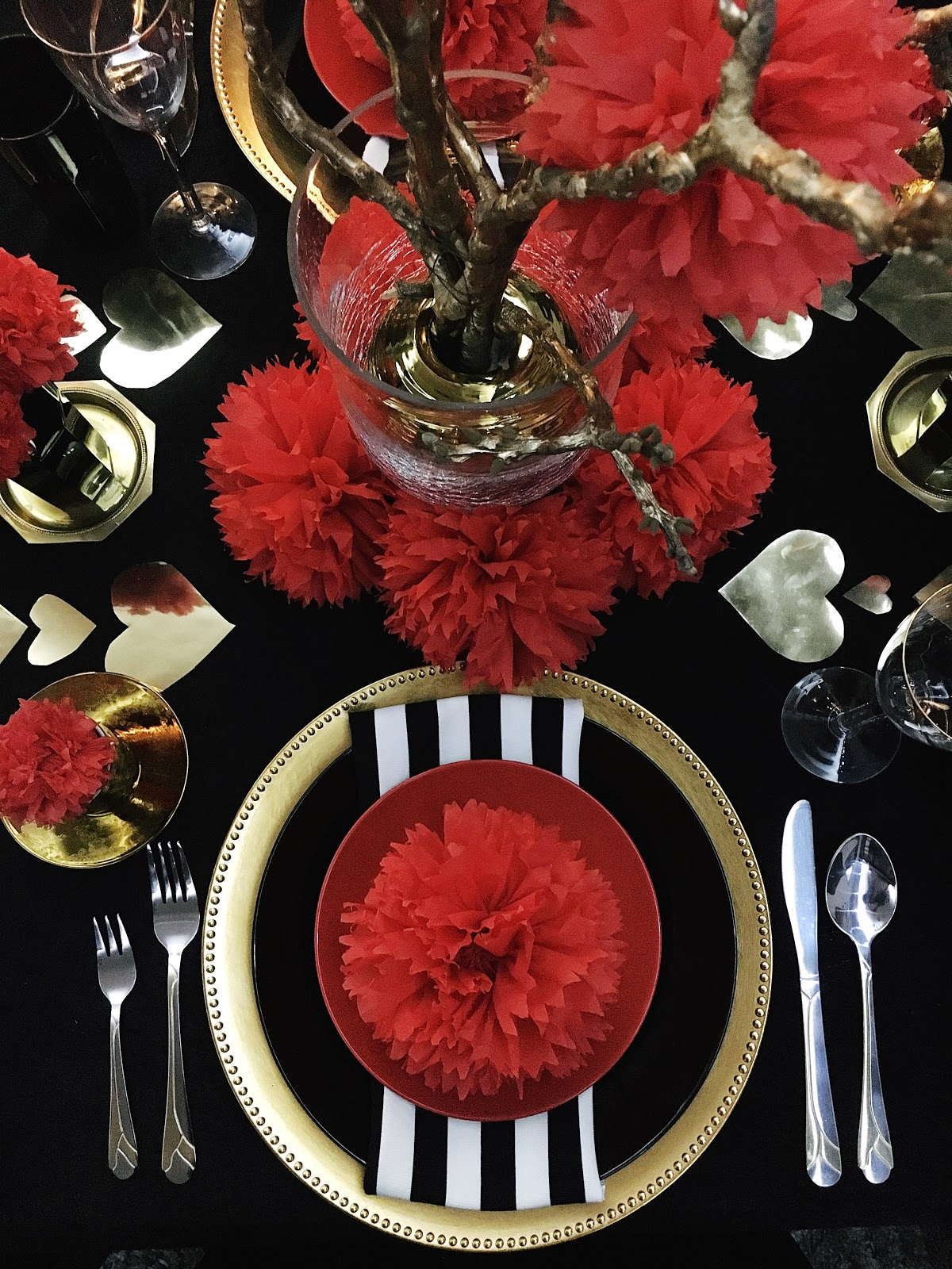 For My Place Settings I Used Gold Chargers Black And Red Plates With Tissue Pom Flower On Top This Striped White Napkin Gives More