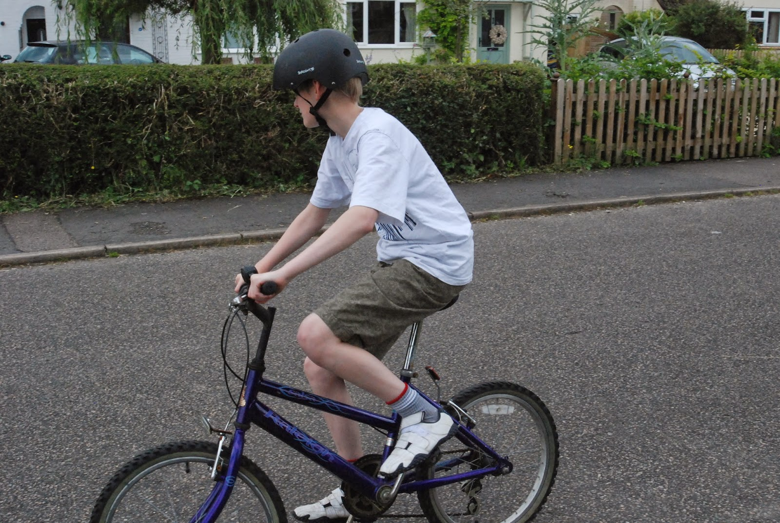 teen on bike wearing skater-style helmet
