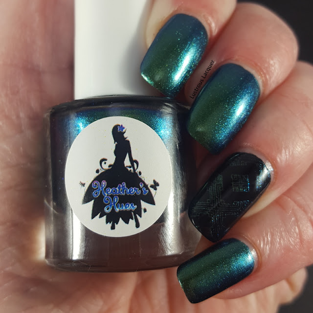 An aqua to green shifting multi-chrome nail polish