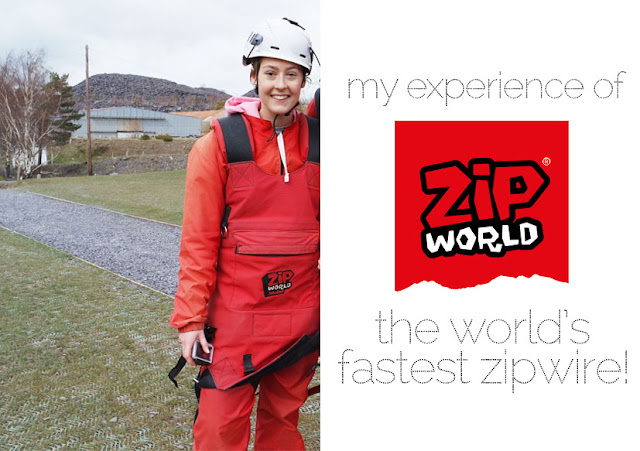 I'm stood in on a gravel path wearing a white helmet and red overalls bearing a red zipworld logo