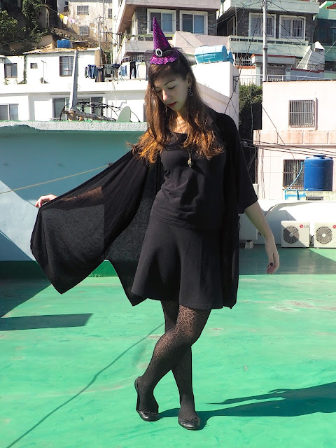 Witch Halloween Outfit | black t-shirt, skirt, ballet shoes and wide sleeved cardigan, spider web tights, and purple witch hat headband