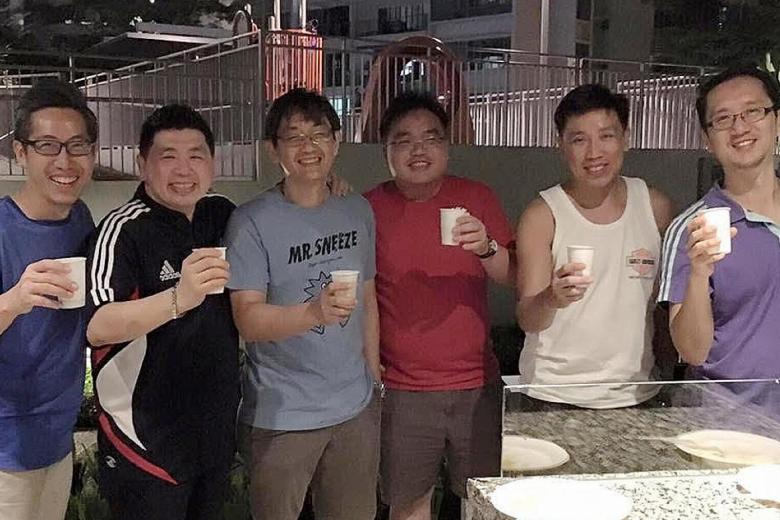 Mr Alvin Goh (far left) and Mr Mark Tan (second from right) took part in The New Paper Big Walk in 1994 with four of their NS buddies.