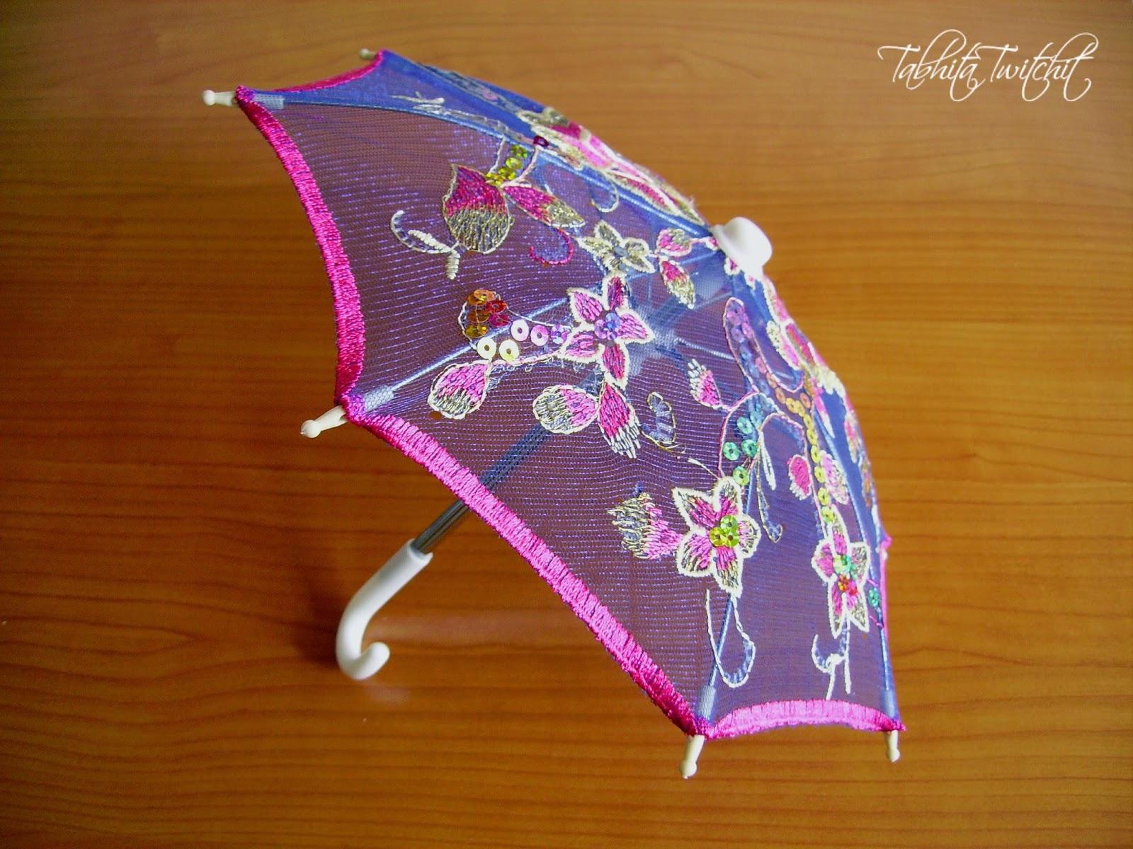 Viva la pepa lluvia de paraguas y una desagradable for Tela para sombrillas