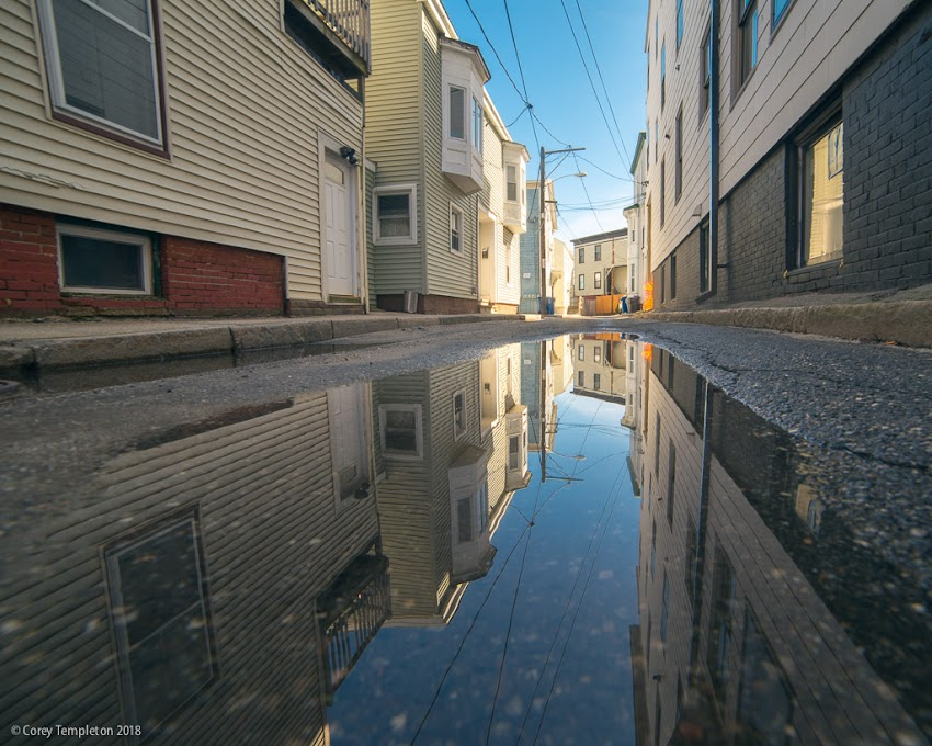 Portland, Maine USA April 2018 photo by Corey Templeton. A leftover puddle on Horton Place, a little street in the West End.
