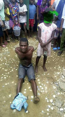 b - Photo: Nigerian man reportedly caught raping little girl