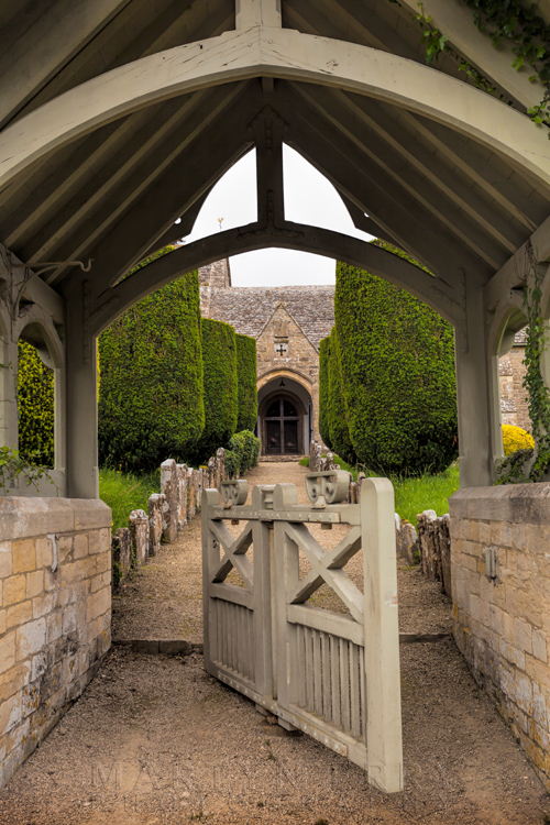 Duntisbourne Abbots church of St. Peter seen through the old swing gate