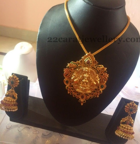 e53310d5d7 Goldplated Temple Set with Jhumkis. Simple gold plated short necklace,  attached with Lakshmi embossed colorful stones huge designer pendant ...