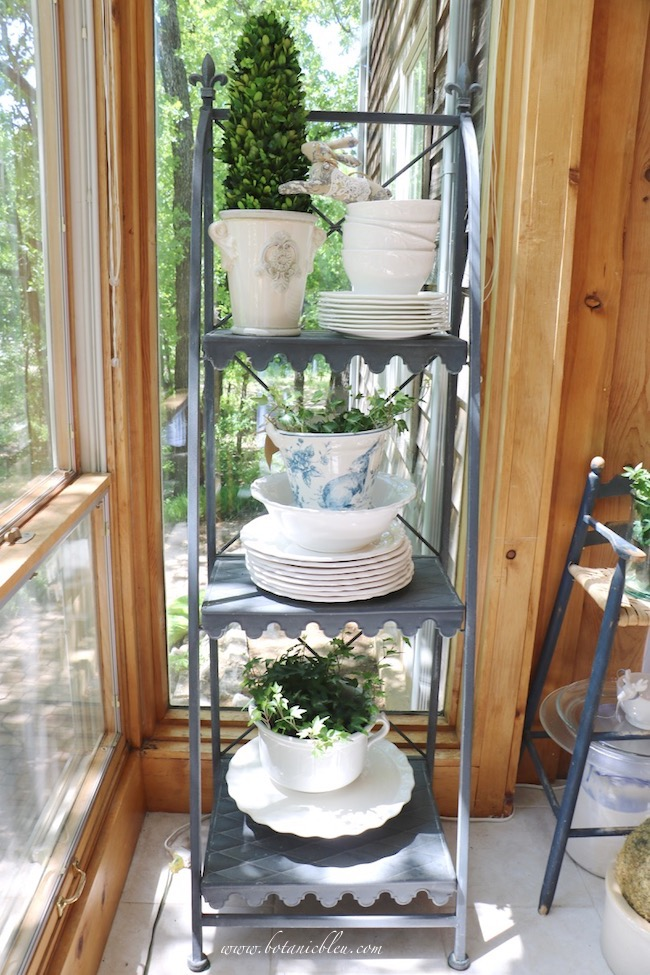 French country Easter plate stand with bunnies, ivy, boxwood, and white dishes