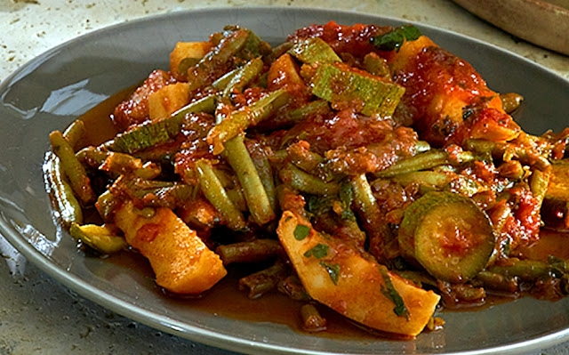 Fasolakia ladera with pumpkins in sauce