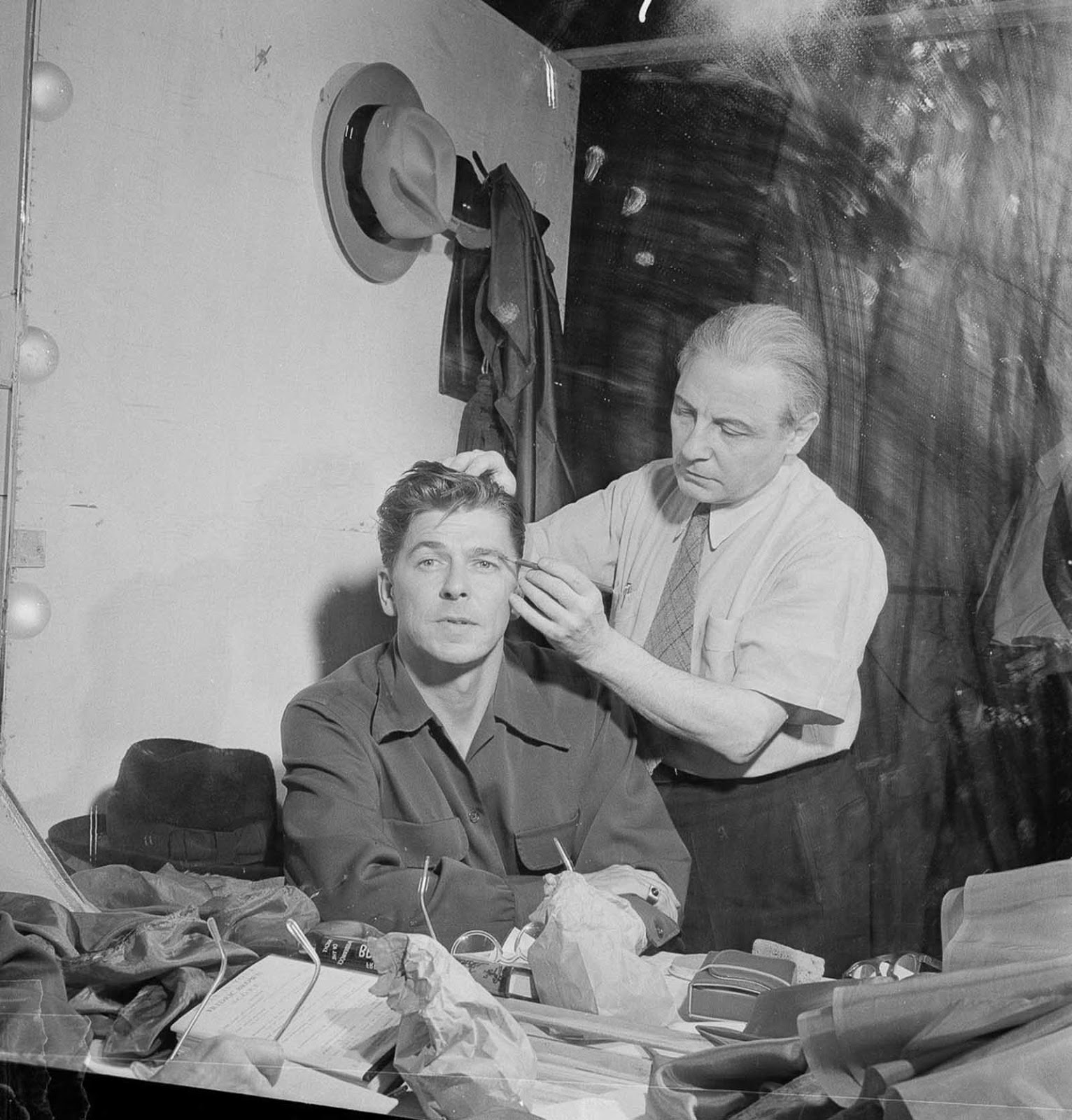 Reagan gets made up for an appearance on an episode of Nash Airflyte Theatre. 1950.