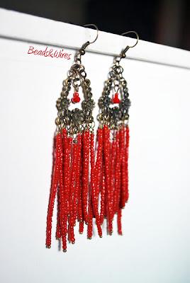 Orecchini red beads