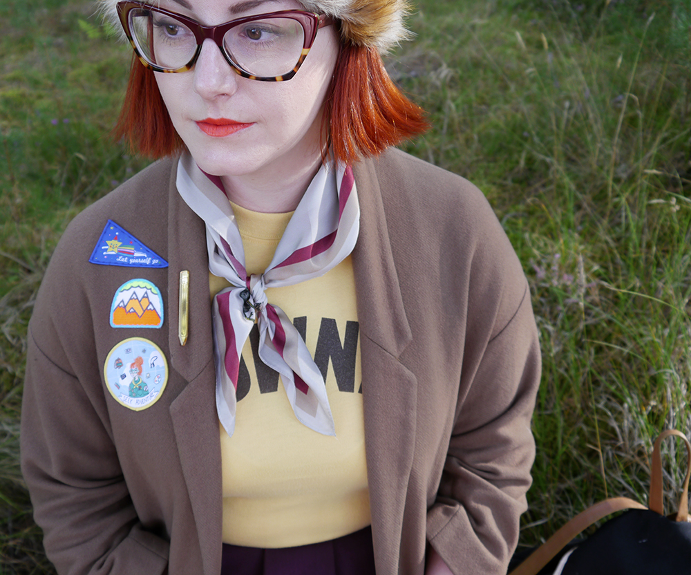 Scottish blogger, style blogger, Moonrise Kingdom outfit, Moonrise Kingdom style, costume idea, Wes Anderson inspired outfit, Sam Moonrise Kingdom, scout style, Moonrise kingdom inspired outfit, vintage style, fur hat, Spex Pistols glasses, patches for adventurers, Lucky Dip Club patches, Olivia Mew cat scarf, vintage Brownies tshirt, Rag Trade Vintage, primark backpack, adventurer style, MMokuyobi Threads patch, Hananh Zakari patch