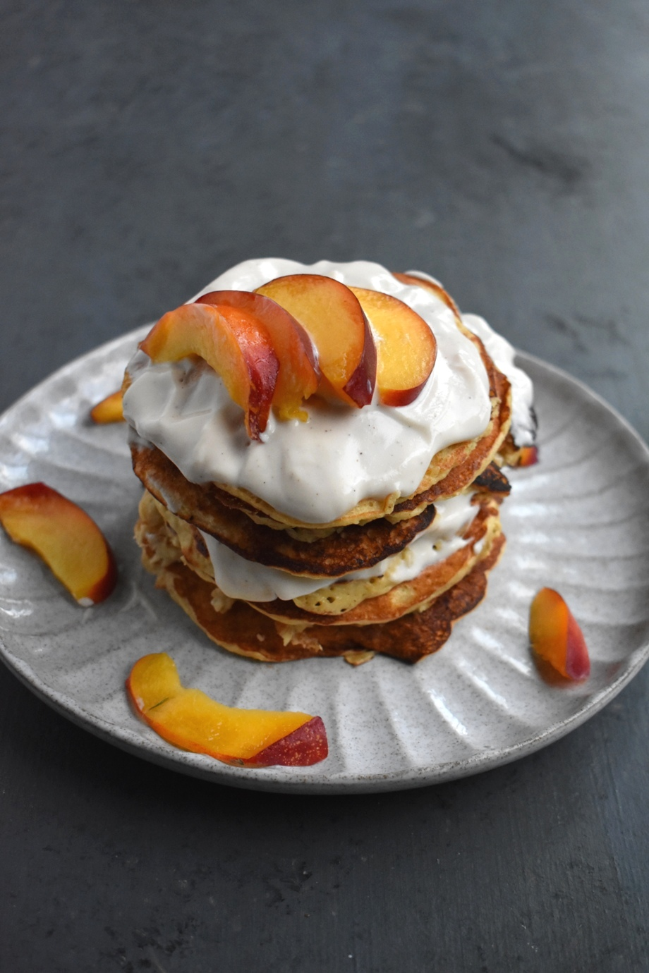Whole-Grain Peaches and Cream Pancakes are dairy-free, whole-grain and full of delicious juicy peaches and cream. They make the perfect breakfast and a great for meal prep! www.nutritionistreviews.com