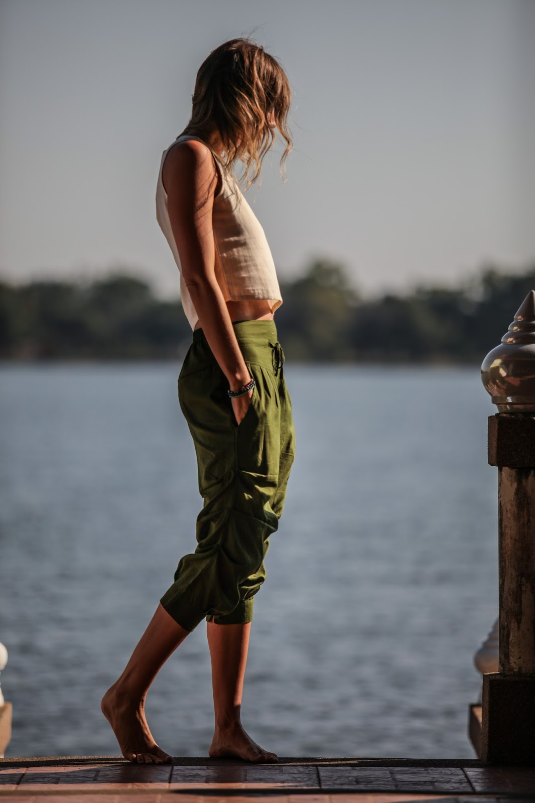 fashion and travel blogger, Alison Hutchinson, is wearing an entire look by Tropic Bliss while at the lake in Chiang Mai, Thailand