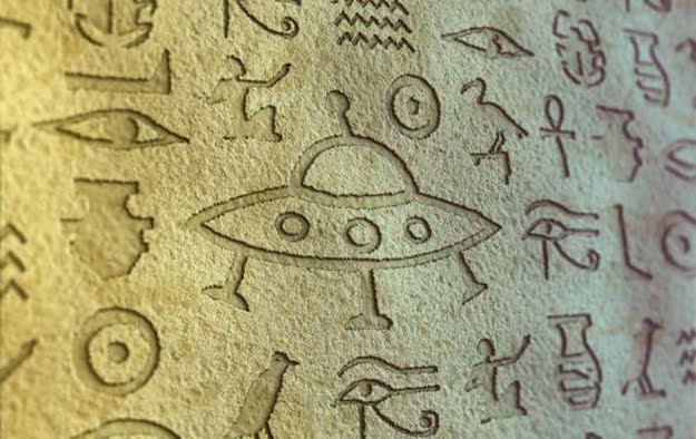 Strange looking UFO in an Egyptian carving on a Pyramid wall.