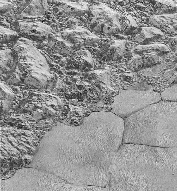 High-resolution image of Pluto's Mountainous Shoreline of Sputnik Planum