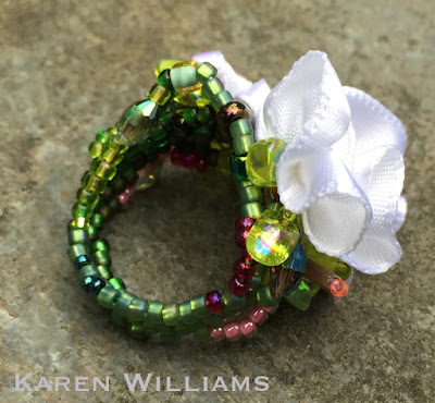 alternate side view of Karen Williams' Apple Blossom freeform peyote ring