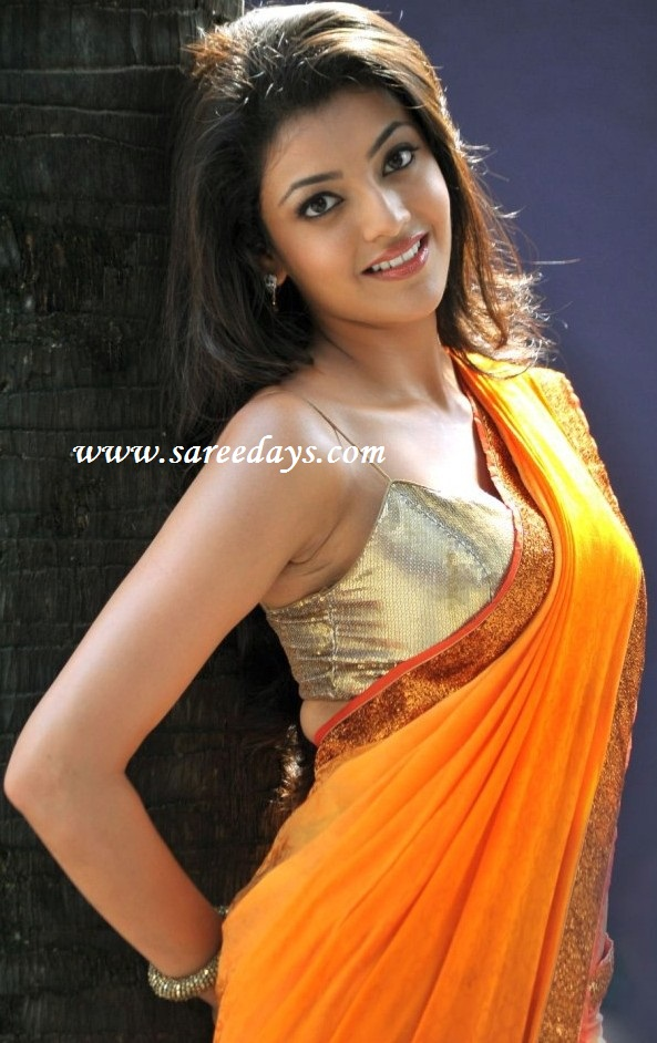 Latest Saree Designs: kajal agarwal in orange designer saree