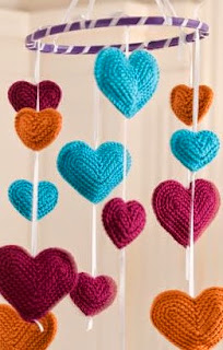 http://www.redheart.com/free-patterns/flying-hearts-mobile