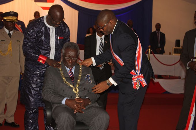 Liberian President, George Weah decorates Ghana's former President Kufuor with Liberia's highest national award