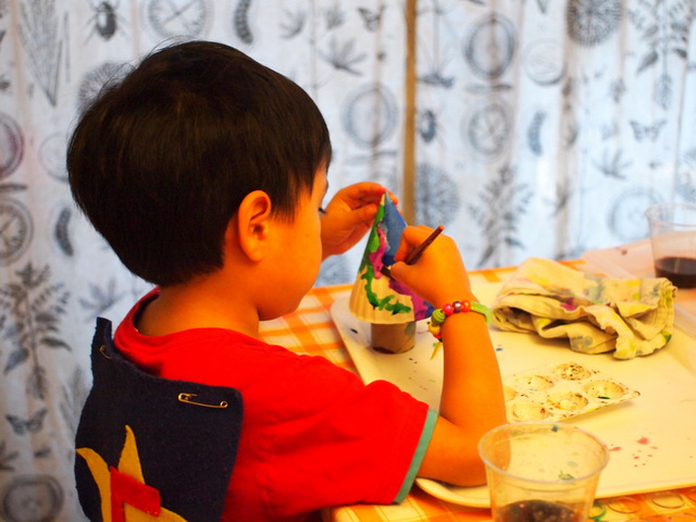 Boy painting 3D Christmas trees