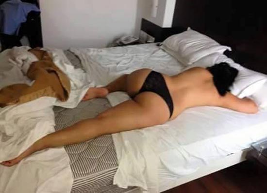 woman strapped naked to bed