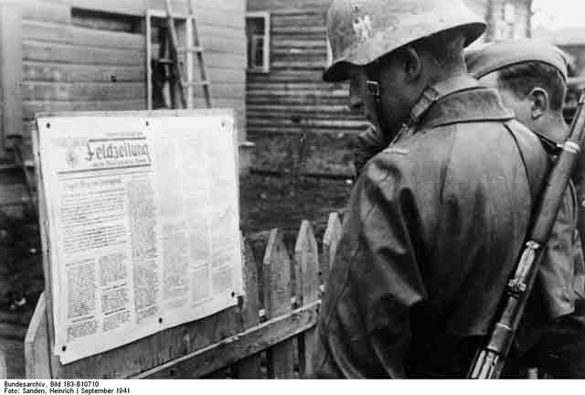 German soldiers read a posted newspaper 26 September 1941 worldwartwo.filminspector.com
