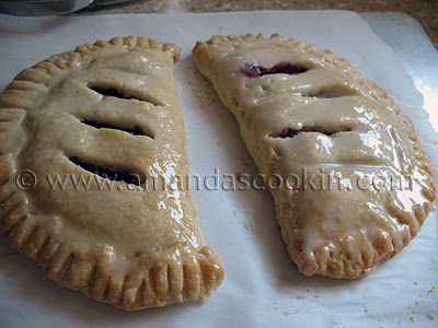 A close up photo of two cherry hand pies.