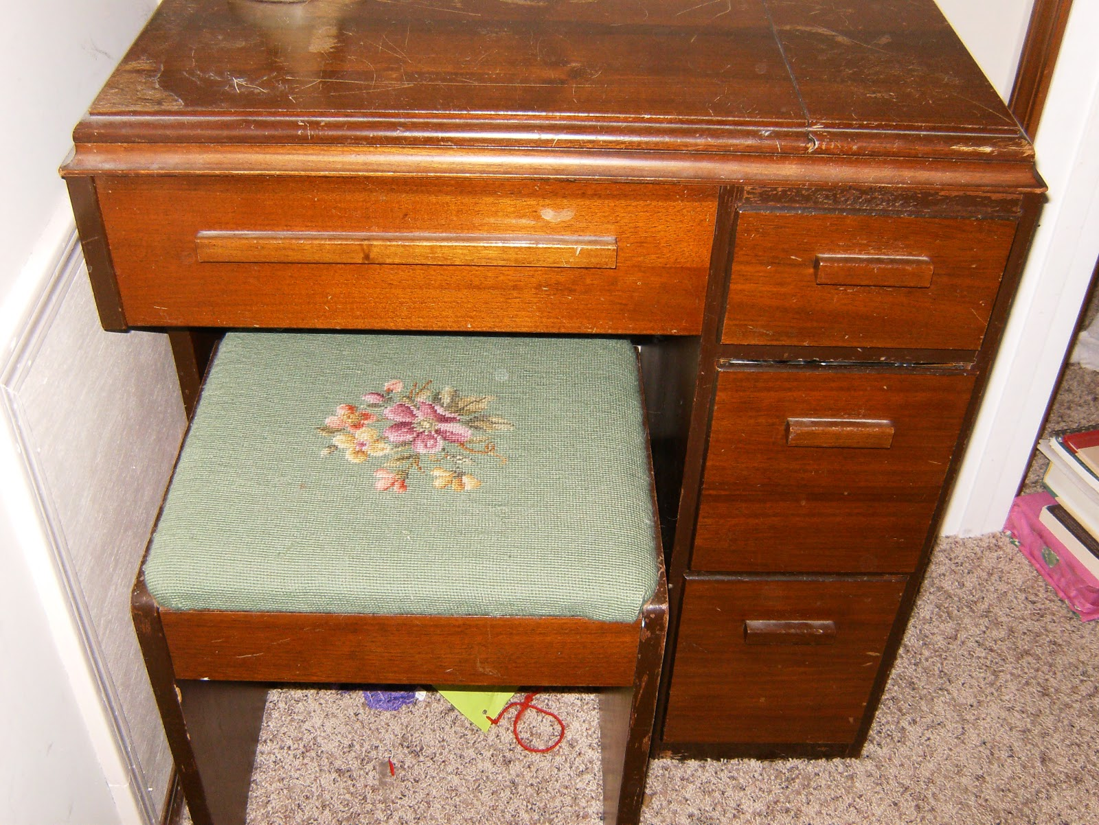 Grandmas Singer sewing machine in wood cabinet