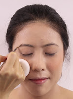 Filling up the brows by using Kate Eyebrow Kit.