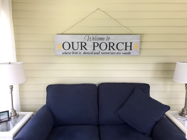 Finished sign hanging over blue sofa