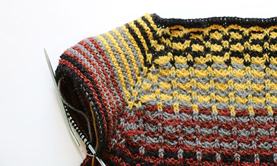 Close-Up of Colorful Striped Knit Sweater Top