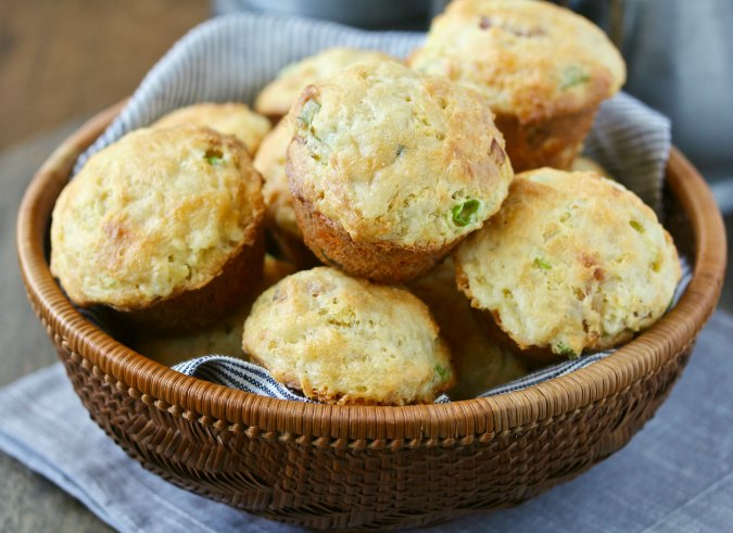 Bacon Scallion Cheddar Corn Muffins in a basket