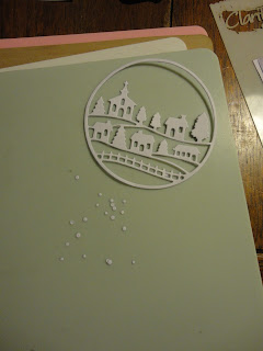 White circular snow scene die cut