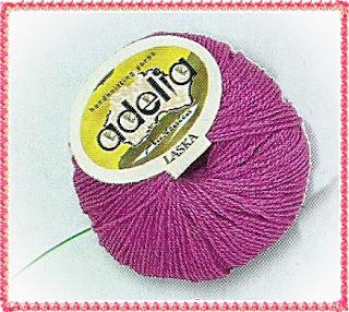 фото пряжи Вязаный розовый пуловер рючком