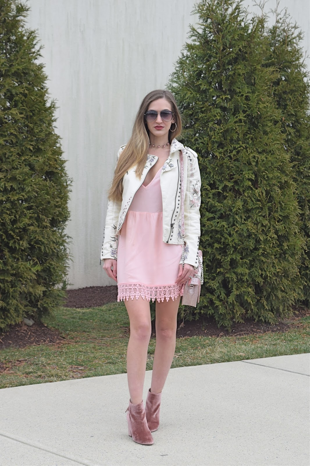 wearing blank nyc vegnan leather embroidered jacket, tobi pink dress, steve madden cynthiav pink velvet booties, wearing clear choker necklace