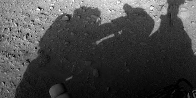 Mans shadow can be seen on Mars while messing with the Mars Rover it's clearly a person on Earth.