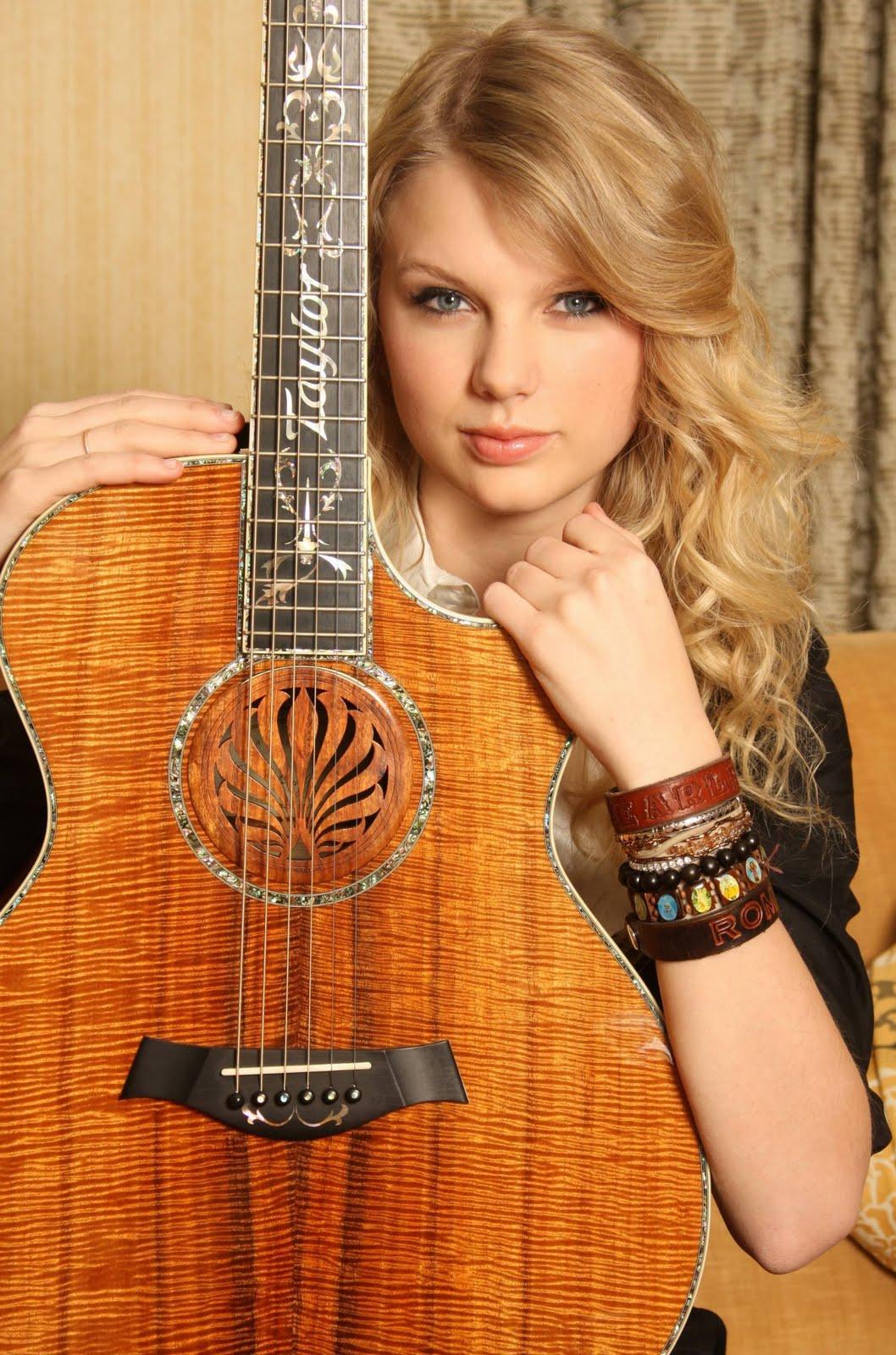 http://3.bp.blogspot.com/-zU9Wg5VqJj0/USx4mgAdWII/AAAAAAAAEIo/yiWmhJ4VRzI/s1600/Taylor+Swift+With+Guitar.jpg