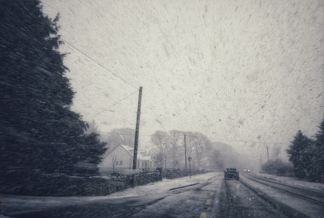 on the road, in the blizzard