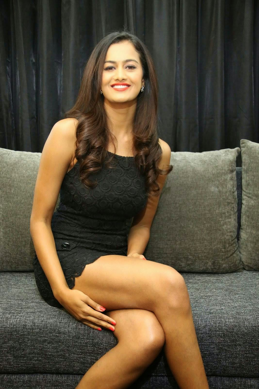 , Shubra Aiyappa Hot Legs & thighs images in Short black Dress