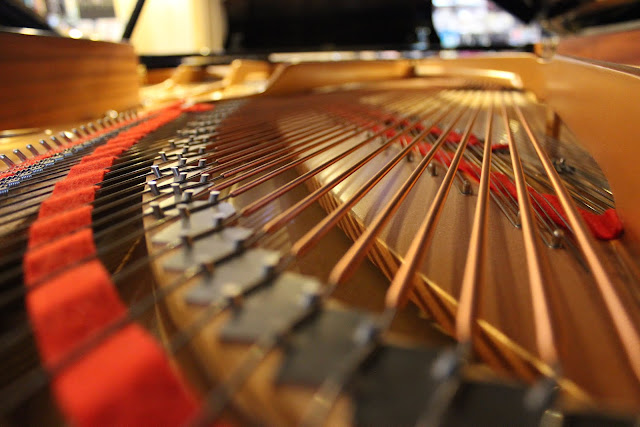 piano strings of 9-foot Yamaha concert grand