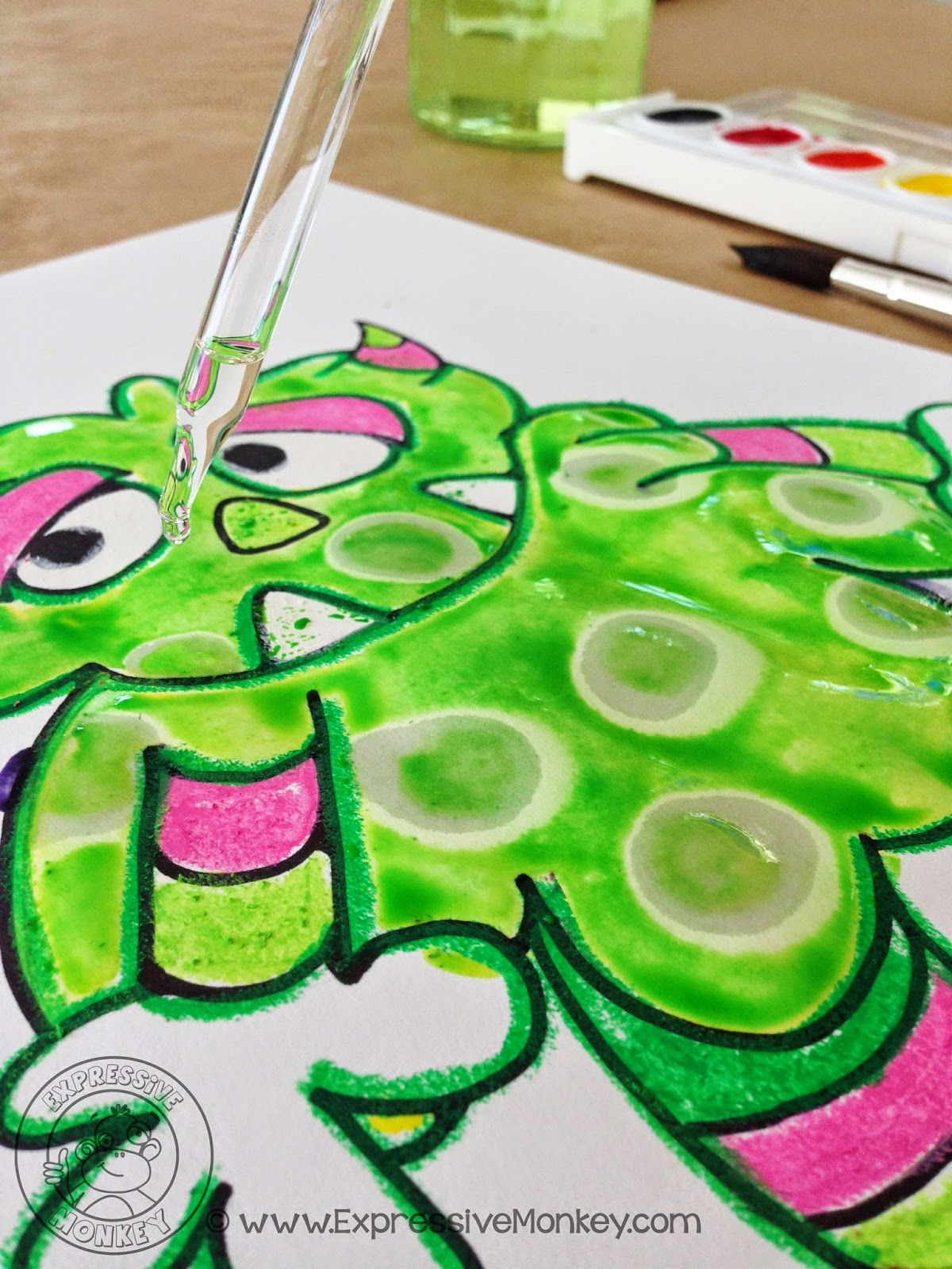 Expressive Monkey demonstrates how to use watercolors and rubbing alcohol to create interesting spots on a monster drawing.