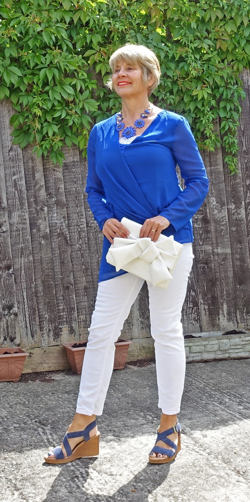 A cobalt blue tunic and white jeans worn by over-45s blogger Gail Hanlon from Is This Mutton?