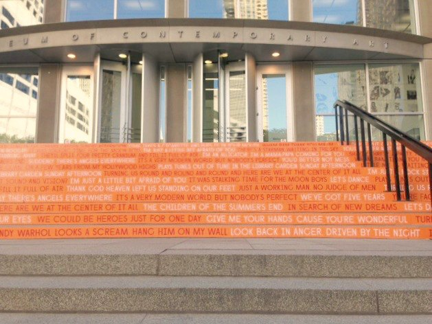 Orange steps with David Bowie song titles at MCA Chicago by Hello Lovely Studio