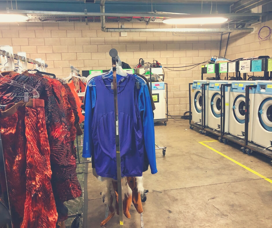 Costumes from Cirque Du Soleil OVO wait to be washed in the washing machines.