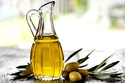 Olive Oil And Rosemary Leaves