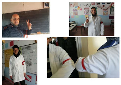 أساتذة يحتجون بالشارات الحمراء (صور)