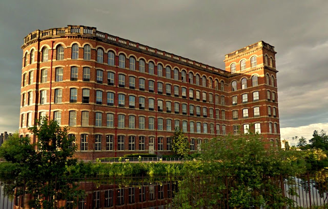 Anchor Mill building catches rays of sunshine from mostly cloudy sky
