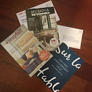 Photo of two catalogs, a post card, and two envelopes of junk mail. https://trimazing.com/