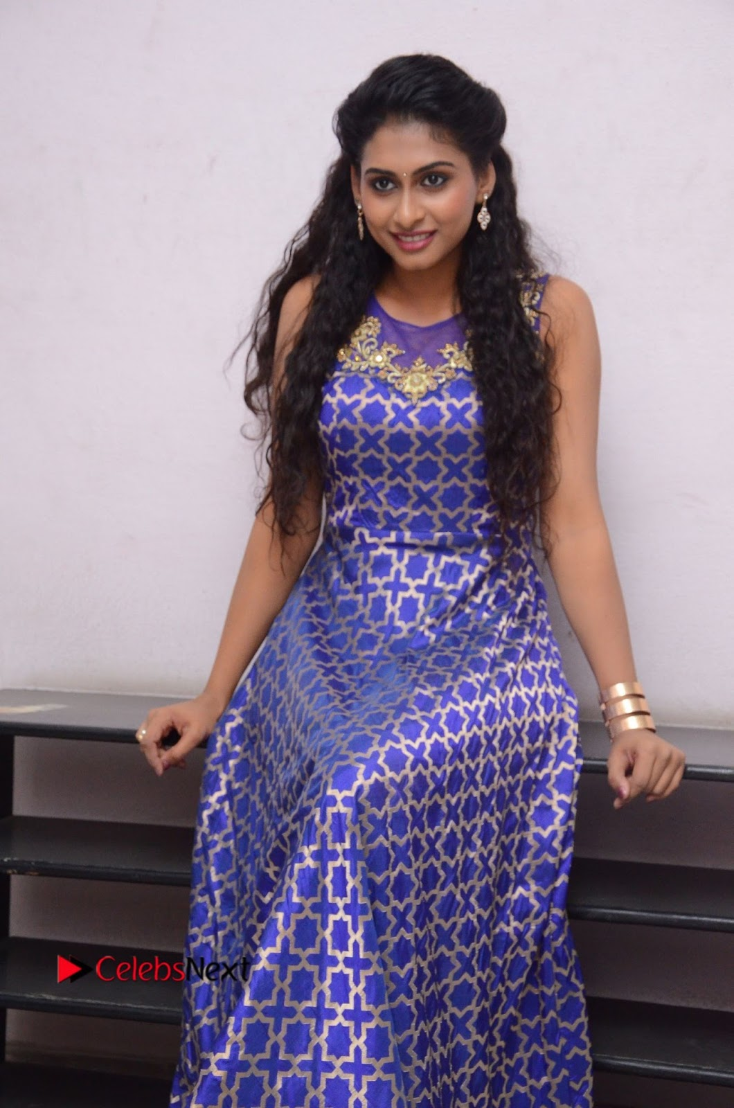 Nithya Naresh Stills in Long Dress at Nandini Nursing Home Platinum Disc Function